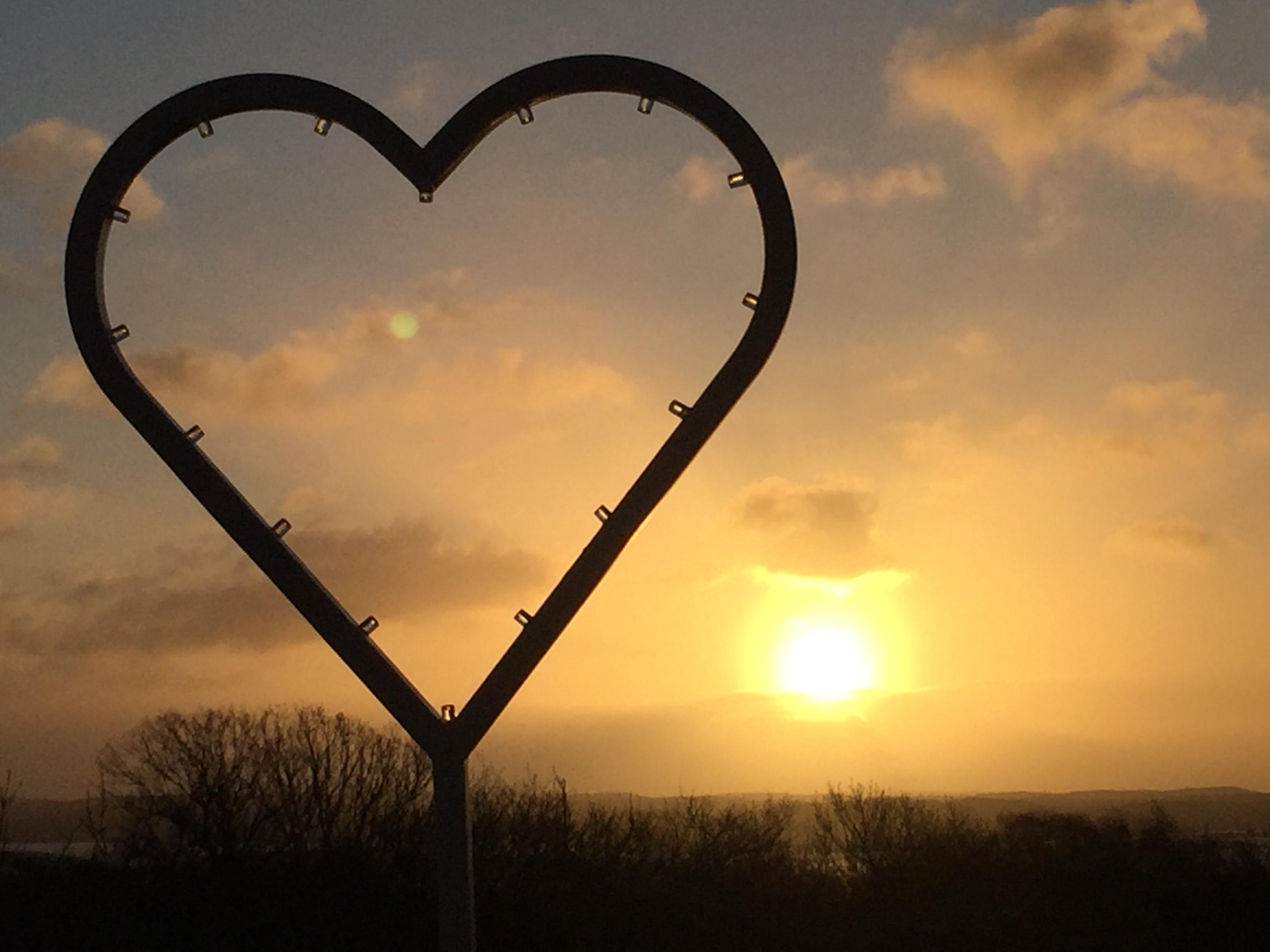 Hjärta med soluppgång